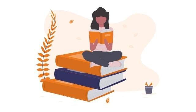 知識を身につけるために読書する女性